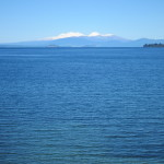Lake Taupo with snow capped mountains behind