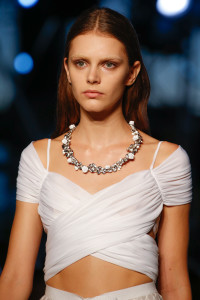 Silver and white circlet necklace pairs naturally with white. From Givenchy.