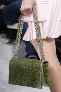 Show case a green handbag.