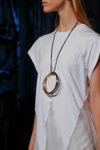 Long silver chain and large gold hooped necklace. Givenchy.