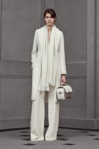 White scarf, white handbag and delicate long gold earrings. Understated elegance. From Balenziaga.