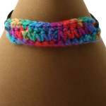 Multi-coloured adjustable bracelet. Tapestry crochet and black chord, adjustable length 16 - 21 cm